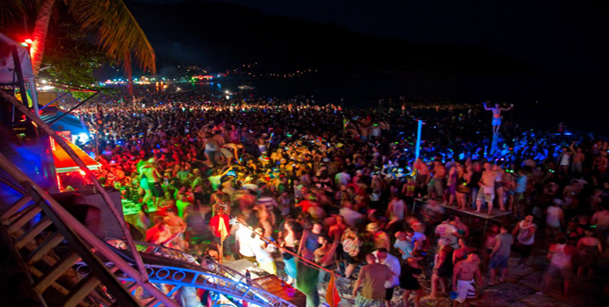 Crowds at the Full Moon Party in Koh Phangan, Thailand. Photo courtesy of In Sea Speedboat.